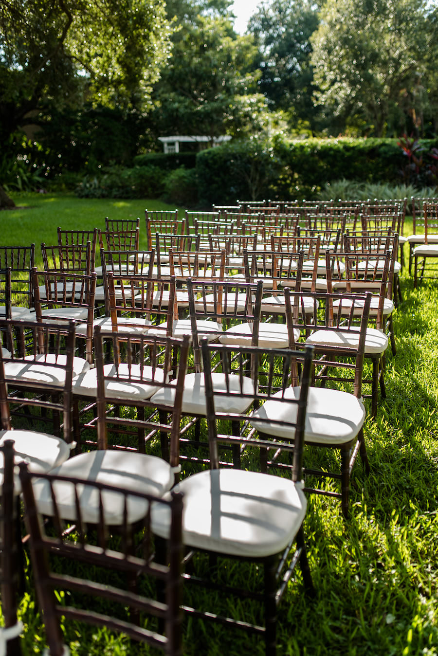 Tampa Garden Club Garden Wedding Ceremony with Wooden Chiavari Chairs with White Cushions