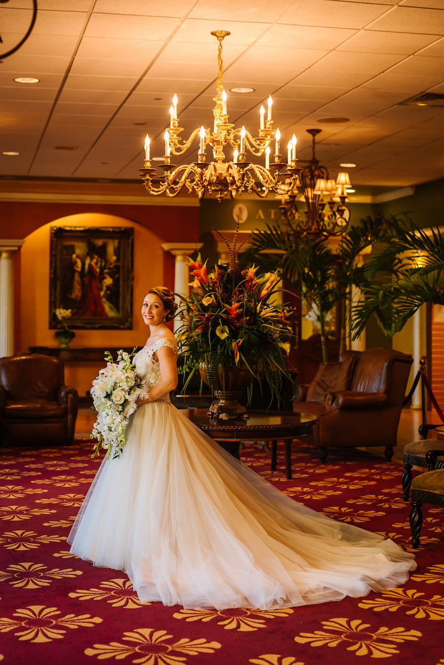 Bridal Portrait wearing Maggie Sottero Wedding Dress with Large White Floral and Greenery Wedding Bouquet   Tampa Bay Wedding Venue Ruth Eckerd Hall