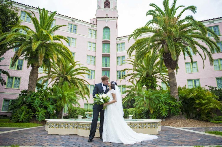 Outdoor Garden Bride and Groom Wedding Portrait, Bride Wearing Augusta Jones Wedding Dress with White Floral with Natural Greenery Bouquet | Downtown St Petersburg Wedding Venue The Vinoy Renaissance