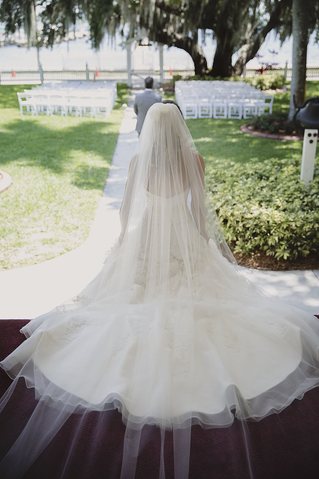 Outdoor Garden Wedding Ceremony Bridal Portrait with Cathedral Train Wedding Dress and Long Veil | Florida Waterfront Wedding Venue Palmetto Riverside Bed and Breakfast