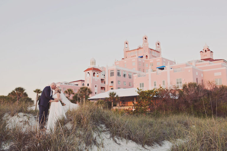 Outdoor Florida Beach Bride and Groom Wedding Portrait | St. Petersburg Historic Hotel Wedding Venue The Don Cesar | Planner Parties a la Carte