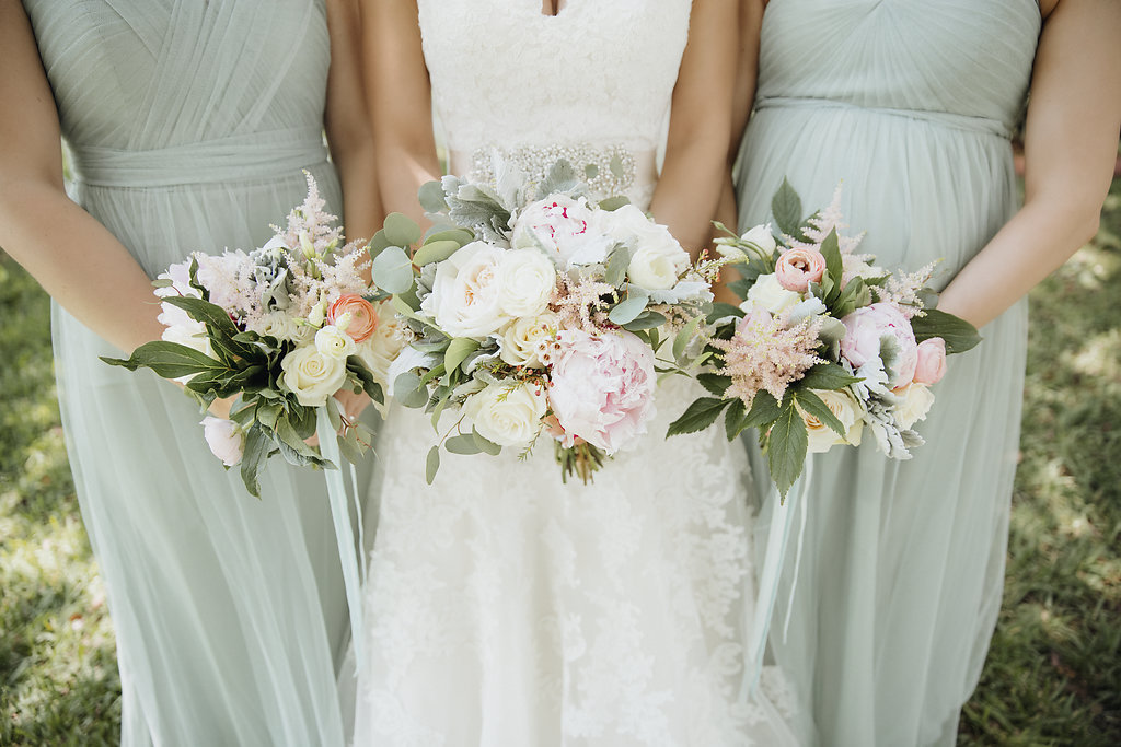 Bridal Party Portrait with Tropical White Rose, Pink Peony, and Peach Florals with Greenery Bouquets and Sea Foam Green Jenny Yoo Bridesmaids Dresses