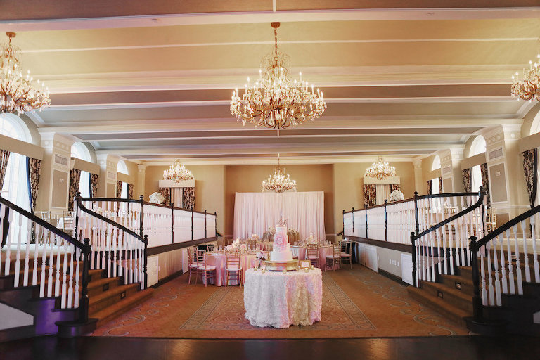 Blush and Gold Hotel Ballroom Wedding Reception with Four Tiered Round White Wedding Cake | St. Petersburg Historic Hotel Wedding Venue The Don Cesar | Planner Parties a la Carte
