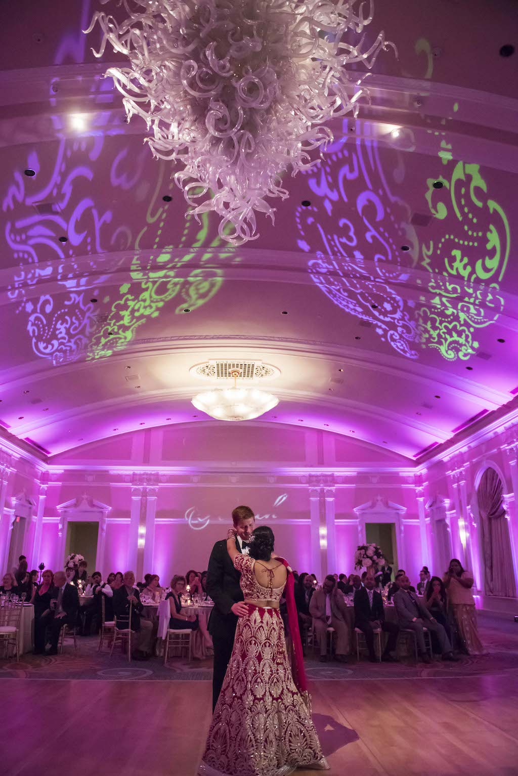 Multicultural Indian Ballroom Wedding with Purple Uplighting and GOBO | Bride and Groom First Dance Portrait | Tampa Bay Wedding Venue The Vinoy Renaissance