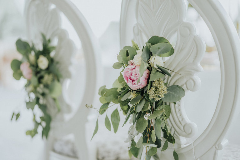 Rustic Wedding Reception Decor with Vintage White Chairs with Pink Peony and Greenery Flowers | Rustic Vintage Sarasota Wedding Rentals Kelly Kennedy Weddings and Events