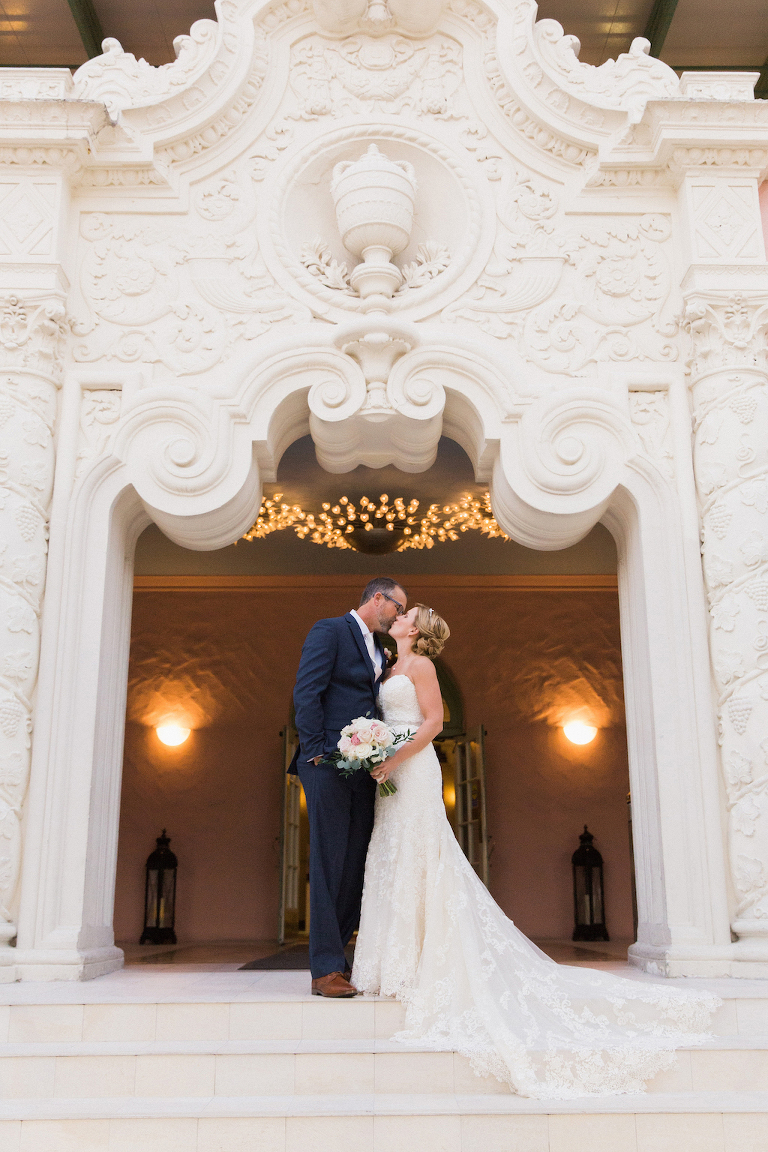 Bride and Groom Wedding Portrait on Front Steps of 1920s Architecture Tampa Bay Wedding Venue The Vinoy Renaissance