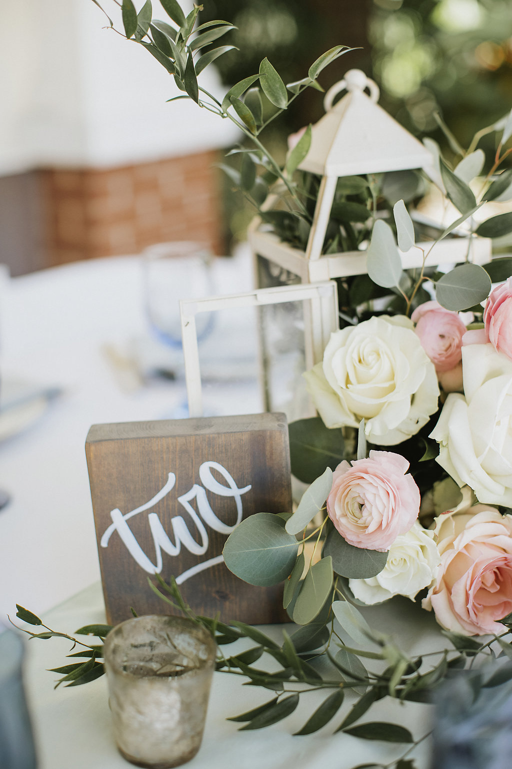 Romantic Vintage Outdoor Wedding Reception Decor | Wood Block Table Number and Lantern Pastel Peach and White Centerpieces