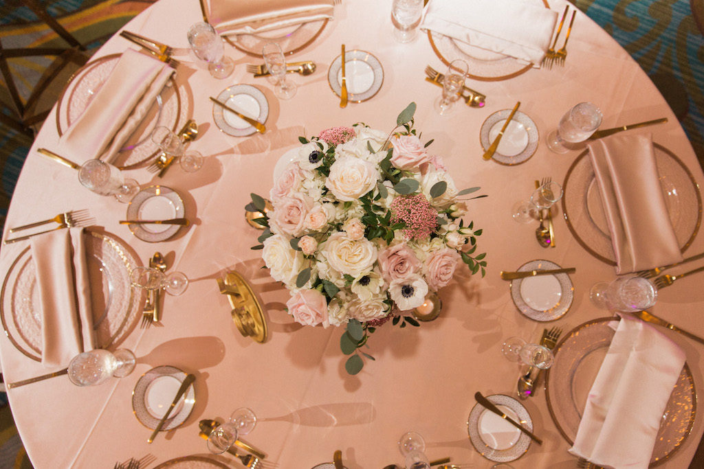 Low Pink Rose and White Anemone Centerpiece with Greenery in with Blush Pink Linens and Gold and White China and Silverware | Tampa Bay Event Planner Parties A La Carte