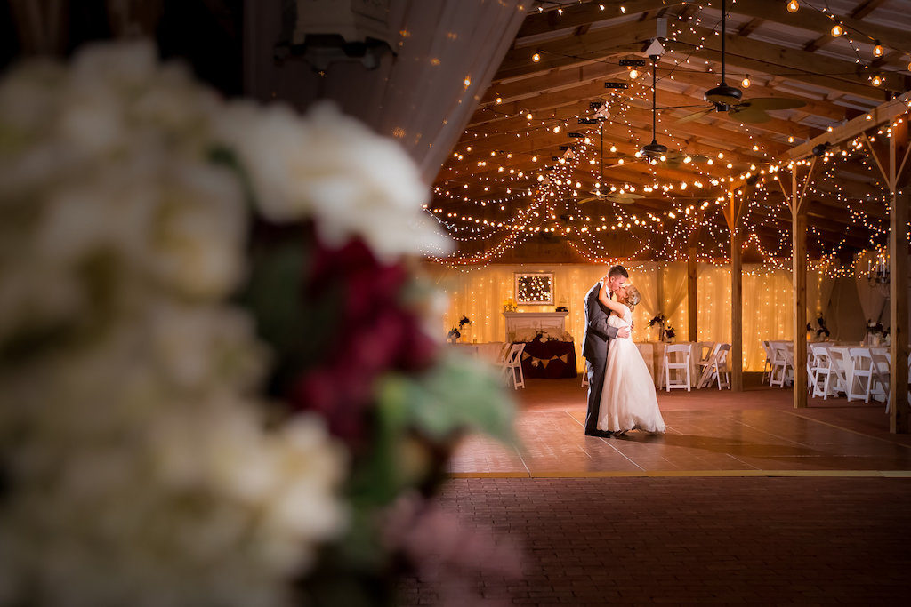 First Dance Portrait with String Lights in Barn Wedding Reception | Tampa Bay Wedding Photographer Rad Red Creative