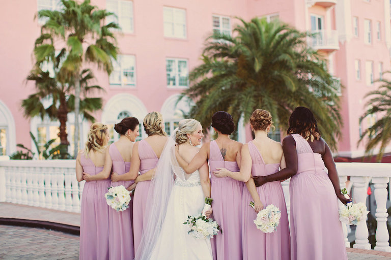 Bridal Party Portrait with Lilac Asymetrical One Shoulder Bridesmaids Dresses and White and Blush Bouquets | Tampa Bay Wedding Venue The Don CeSar