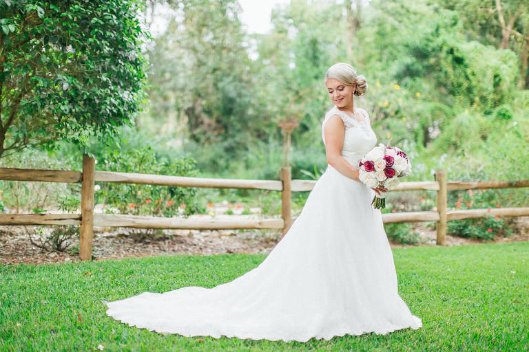 Outdoor Garden Bridal Portrait with Blush, Red, and Cream Rose Bouquet and Lace Wedding Dresses | Tampa Bay Wedding Photographer Rad Red Creative | Bridal Shop Truly Forever Bridal