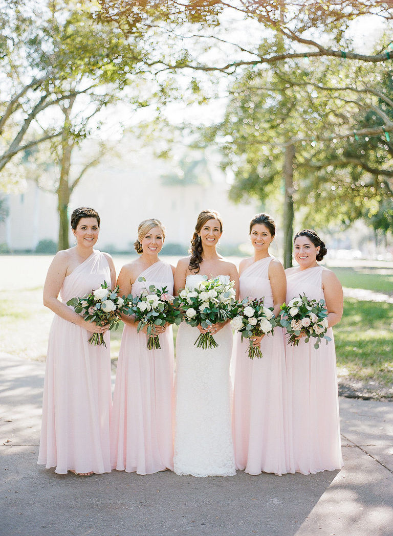 Outdoor Bridal Party Portrait with Asymetrical One Shoulder Floor Length Blush Pink Bridesmaids Dresses and White with Greenery Bouquets | Tampa Bay Wedding Hair and Makeup Artist Michele Renee the Studio