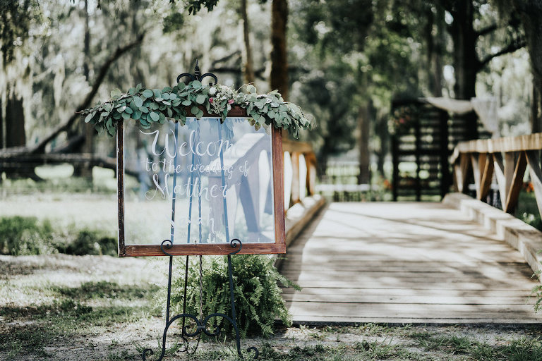 Stylish Wedding Ceremony Wedding Sign with Garland | Tampa Bay Outdoor Garden Wedding
