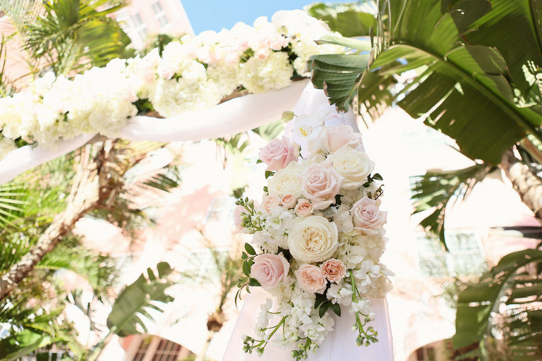 Outdoor Wedding Ceremony Arch Decor with Blush Pink and White Rose with Greenery Flowers and White Drapery | Tampa Bay Wedding Planner Parties A La Carte