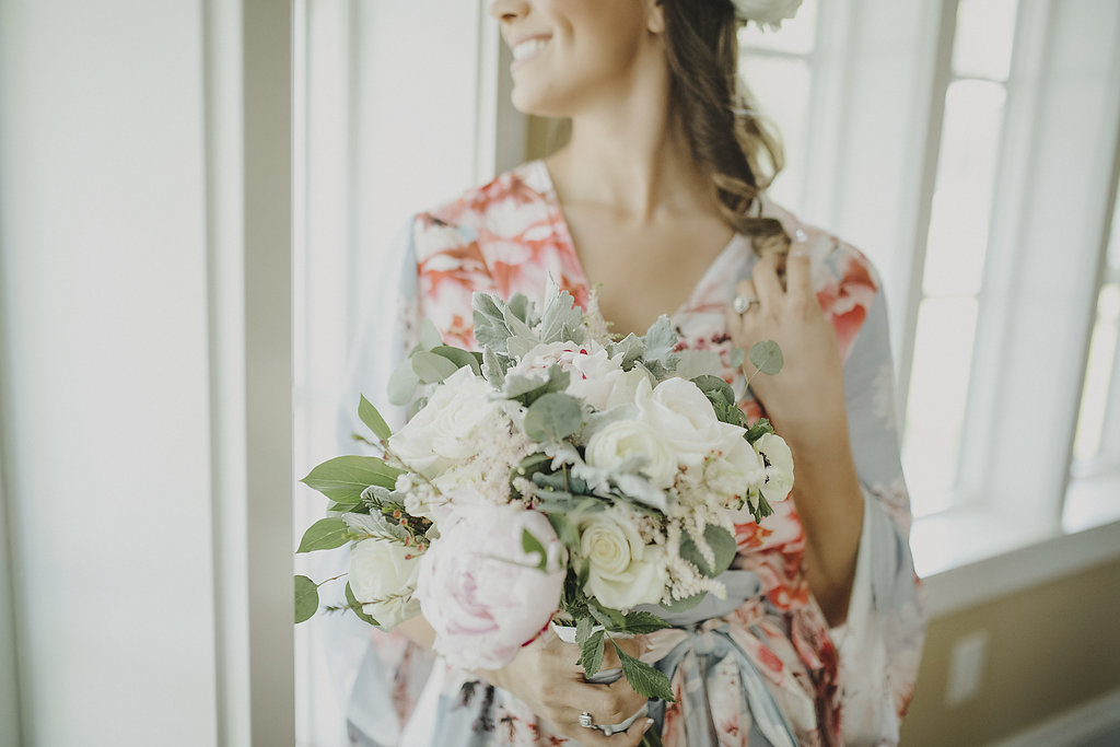 Bride Getting Dressed Portrait in Silk Floral Robe with White Rose and Pink Peony Bouquet with Greenery