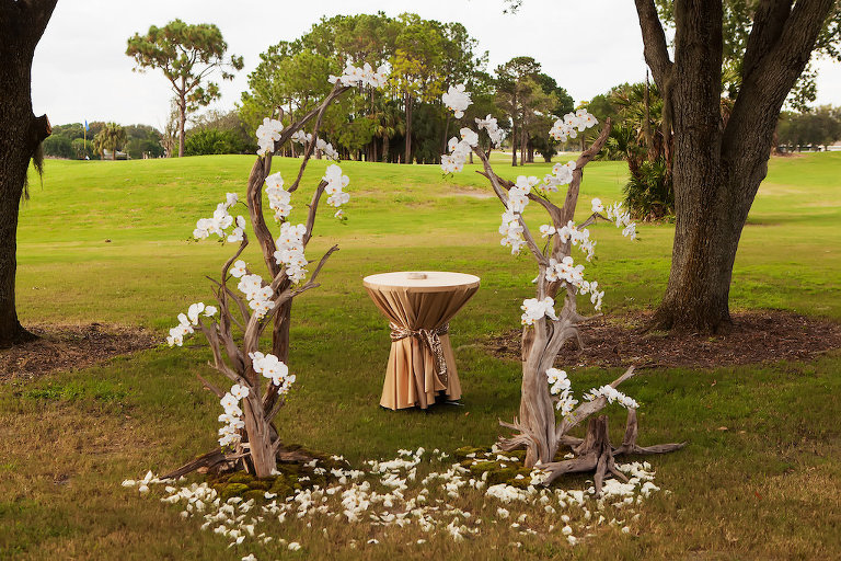 Driftwood Ceremony Arch with White Orchids and Gold Linen Draped Table | Clearwater Garden Wedding Venue Countryside Country Club