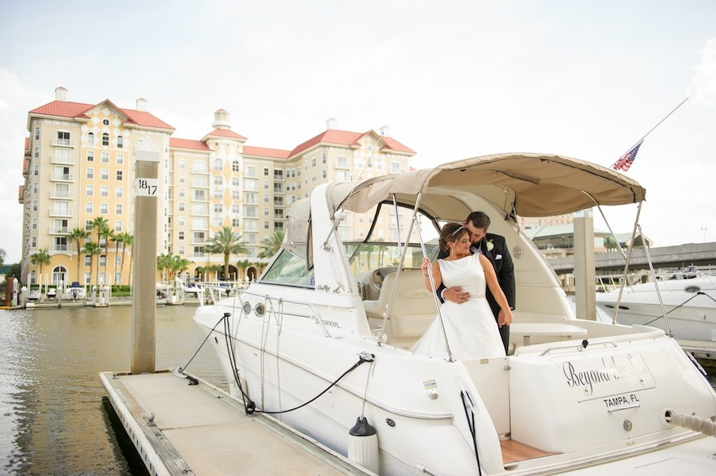 Bride and Groom Wedding Portrait on a Boat | Downtown Tampa Waterfront Wedding Venue Tampa Marriott Waterside | Tampa Bay Wedding Photographer Andi Diamond Photography