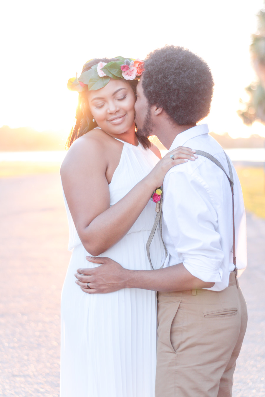 Outdoor Sunset Wedding Bride and Groom Portrait, Groom in Suspenders and Tan Pants in White Cotton Shirt, Bride in Boho Collumn Wedding Dress with Peach and Blush Rose with Greenery Floral Crown Hair Accessory   St Pete Outdoor Wedding Venue Lake Maggiore Park