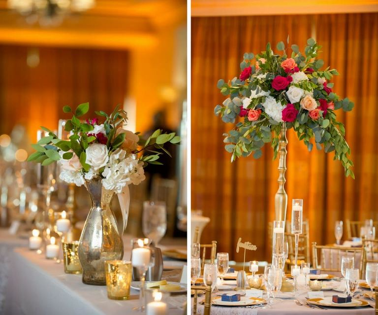 Old Florida Style Ballroom Wedding Table Decor with Tall Antique Gold and Silver Peach, Red, and White Rose with Greenery Centerpieces, and Gold Mercury Votive Candles