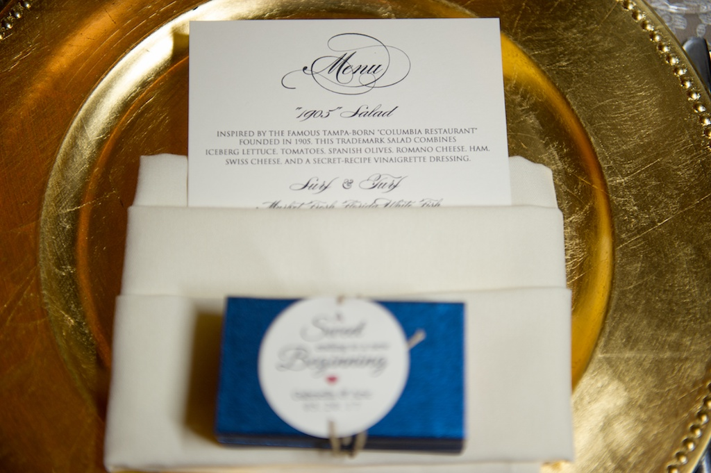 Stylish Navy and White Printed Wedding Menu on Gold Charger with Blue Wedding Favor with Round Printed Tag | Day of Stationery Invitation Galleria