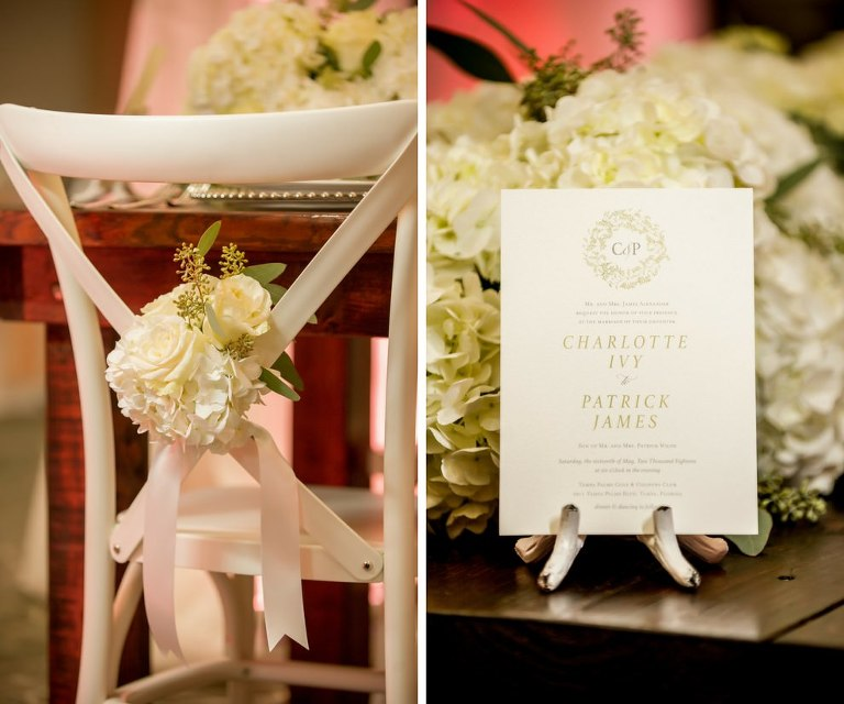 Elegant Southern Wedding Reception Table Decor Details with White Hydrangea and Cream Rose with Greenery and Ribbon on X Back White Chair, Wood Farmhouse Table, and Green Floral and White Wedding Program | Tampa Bay Wedding Planner Love Lee Lane | Tampa Wedding Paper Goods Company A&P Designs | Florist and Rentals Gabro Event Services | Wedding Chair Rentals A Chair Affair