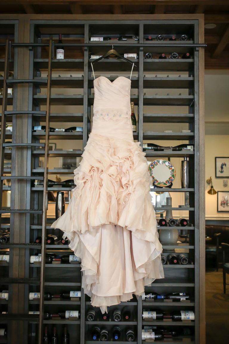 Blush Ruffled Mermaid Strapless Sottero and Midgley Wedding Dress on Hanger