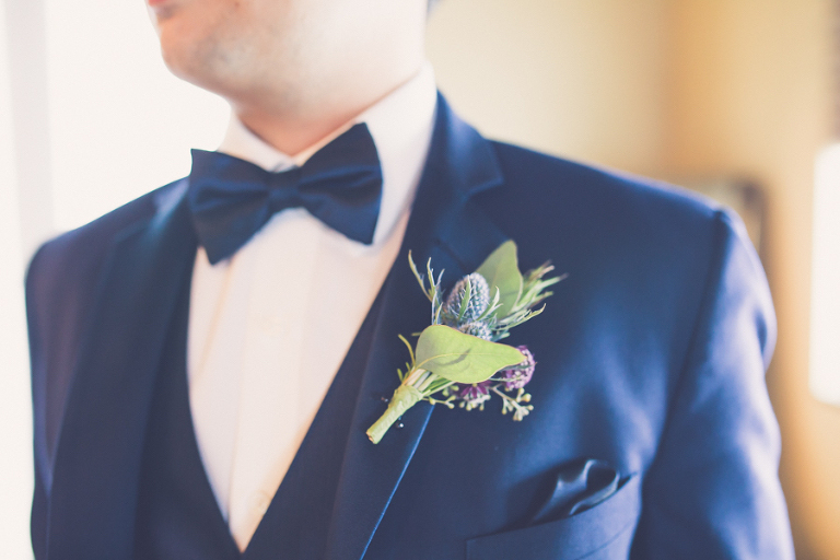 Navy Blue Groom Tuxedo with Blue Thistle and Purple Flowers and Greener Boutonniere