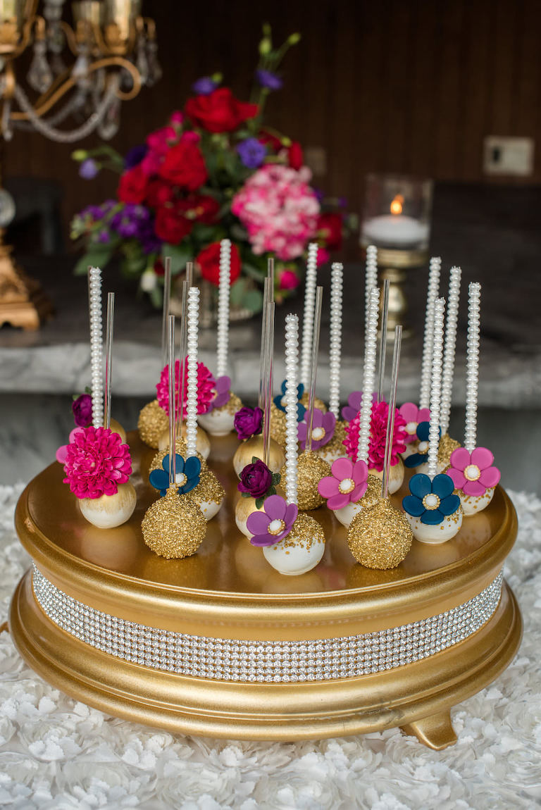 Gold, Purple, Pink, Navy Flower Cake Pops with Pearl Lollipop Sticks on Rhinestone Gold Cake Stand | Tampa Bay Wedding Desserts Sweetly Dipped Confections