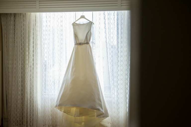 A Line Pronovias Wedding Dress with Belt On Hanger | Tampa Wedding Bridal Salon Isabel O'Neal Bridal