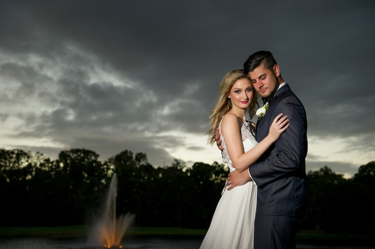 Outdoor Nighttime Bride and Groom Garden Wedding Portrait, Groom in Gray Tuxedo with White Floral Boutonniere | Tampa Bay Wedding Photographer Andi Diamond Photography | Tampa Wedding Makeup and Hair Artist Michele Renee The Studio