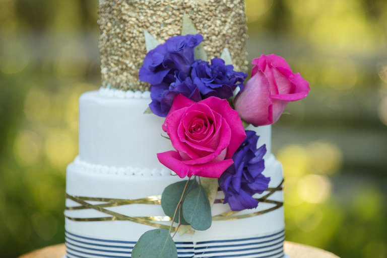 Colorful Three Tier Round White Wedding Cake with Gold Foil and Navy Stripes and Pearls on Gold Cake Stand, with Purple and Hot Pink Roses | Tampa Bay Wedding Cake Bakery A Piece of Cake