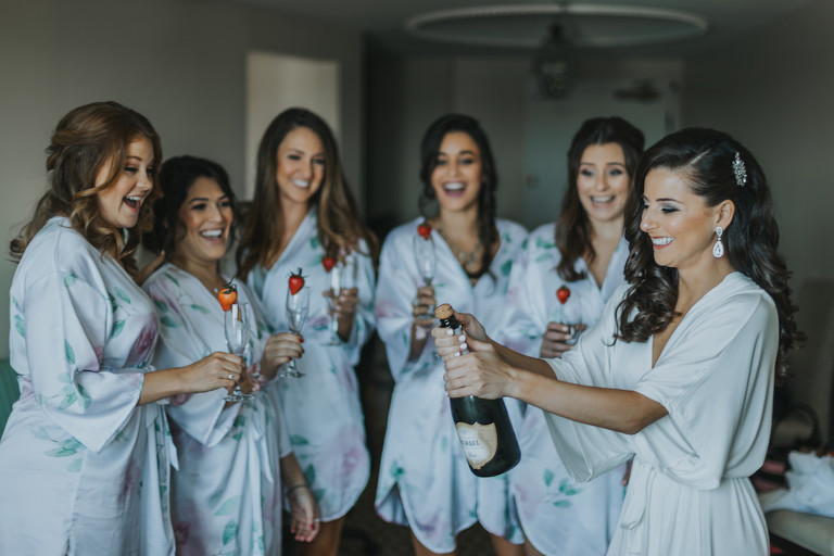 Bridal Party Getting Ready Portrait in Matching Blue Silk Floral Robes with Champagne | Bridal Getting Ready Accommodations St Pete Historic Hotel Wedding Venue The Vinoy Renaissance