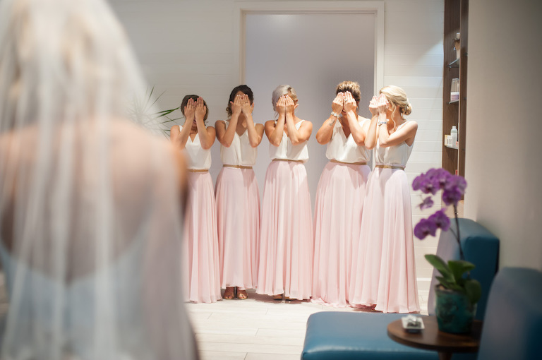 Bridal Party Getting Ready First Look Portrait with Two Piece White Tops and Long Blush Pink Skirts Bridesmaids Dresses | Boho Wedding Style