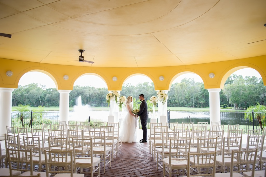 Elegant Wedding Ceremony Decor with Tall Hydrangea Florals with Greenery in Bold White Vases on Pedestals and White Chiavari Chairs | Tampa Bay Country Club Wedding Venue The Palms Tampa Golf & Country Club | Tampa Wedding Rentals A Chair Affair | Wedding and Event Planner Love Lee Lane