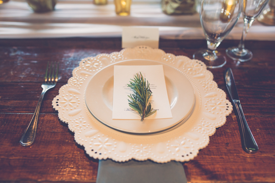 Elegant Modern Rustic Wedding Reception Table Decor with Ceramic Lace Charger and Rosemary on Gray Linen