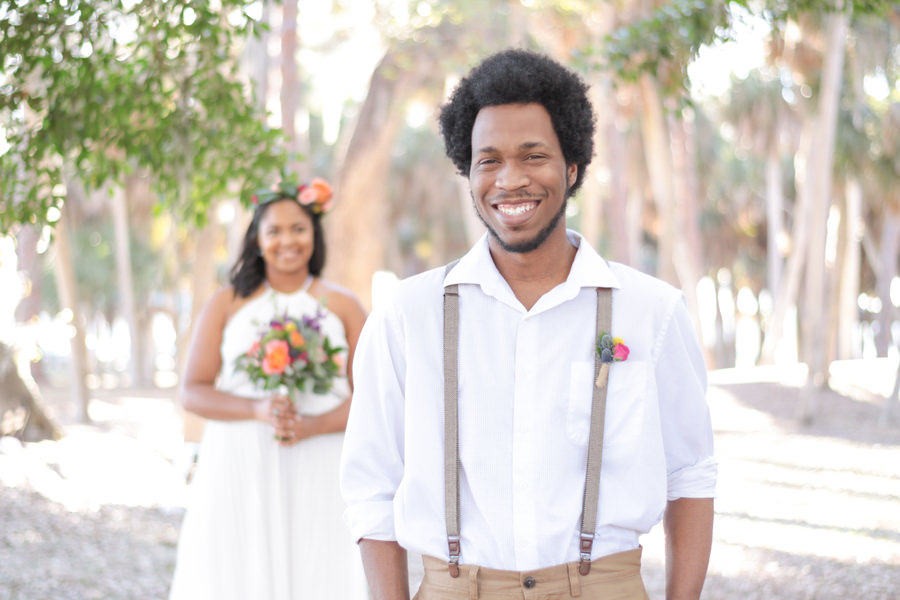 Summer Floral Bohemian Wedding Outdoor Bride and Groom Portrait with Peach Rose, Purple and Yellow Floral, Succulent and Greenery Wedding Bouquets, and Bright Purple and Blush Floral Hair Accessories, Groom with Suspenders and White Cotton Shirt, with Succulent, Pink and Yellow Floral Twine Wrapped Boutonniere