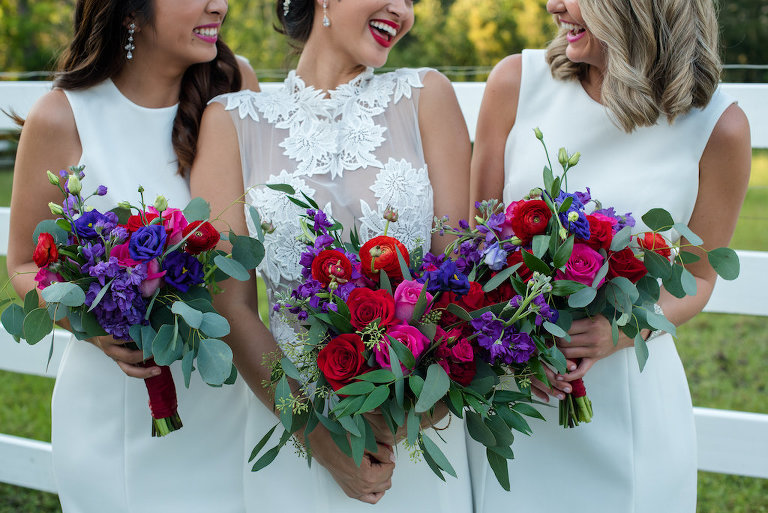 Outdoor Bridal Party Portrait with Red, Purple, and Greenery Bouquet from Tampa Florist Northside Florist, in A Line Lace Wedding Dress from The Bride Tampa, Bridesmaids in Classic White Dresses from Truly Forever Bridal   Hair and Makeup by Michele Renee The Studio   Caroline & Evan Photography