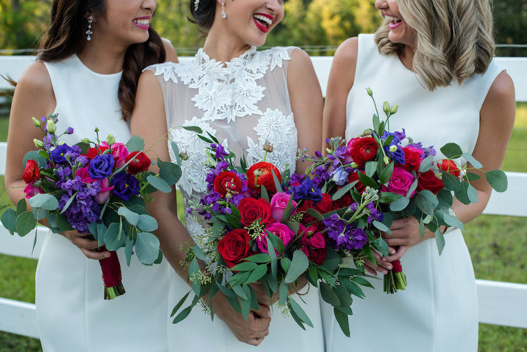 Outdoor Bridal Party Portrait with Red, Purple, and Greenery Bouquet from Tampa Florist Northside Florist, in A Line Lace Wedding Dress from The Bride Tampa, Bridesmaids in Classic White Dresses from Truly Forever Bridal | Hair and Makeup by Michele Renee The Studio | Caroline & Evan Photography