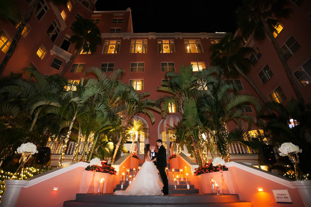 Outdoor Nighttime Courtyard Garden Wedding Ceremony Portrait with Floating Votive Candles in Glass Cylinder Vases | St Pete Beach Historic Hotel Wedding Venue The Don Cesar