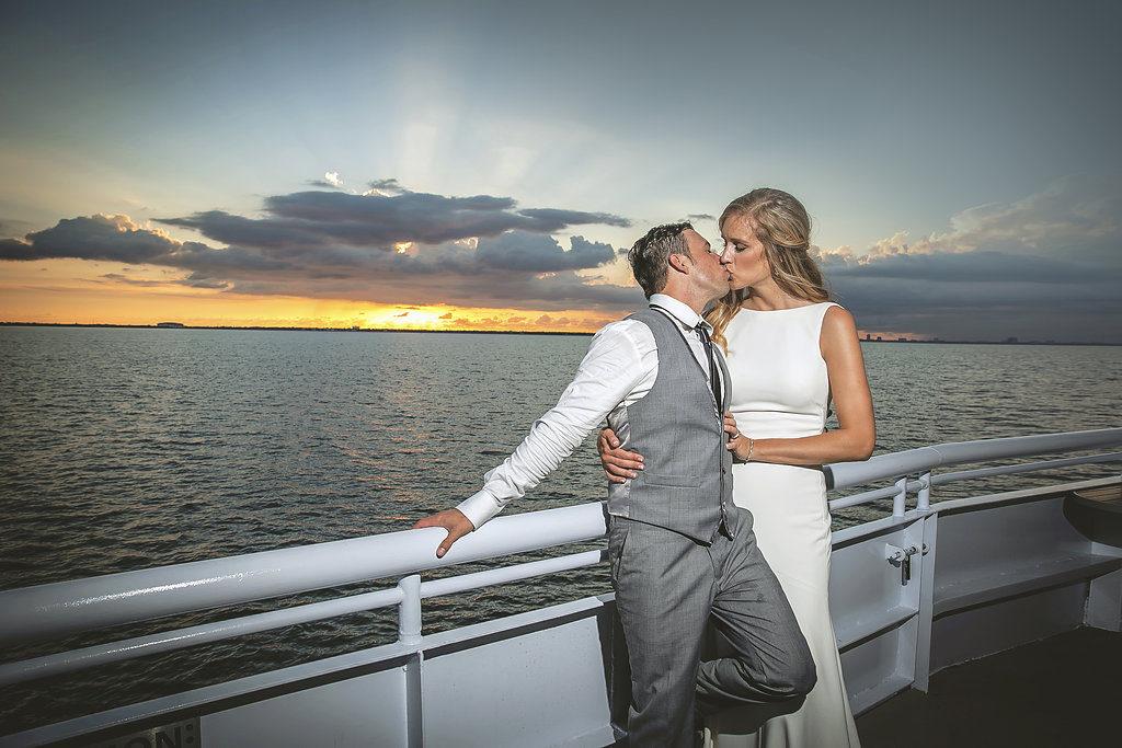 Bride and Groom Outdoor Waterfront Wedding Portrait, Groom in Gray Suit | Downtown Tampa Unique Wedding Reception Venue Yacht Starship | Danny Mastronardo and Shelbey Bleke Wedding Portrait