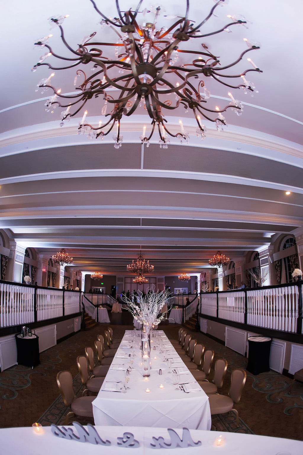 Winter White and Silver Black Tie Hotel Ballroom Wedding Reception with Long Feasting Table with Tall White Branch Centerpiece   Tampa Bay Historic Wedding Reception Venue The Don Cesar