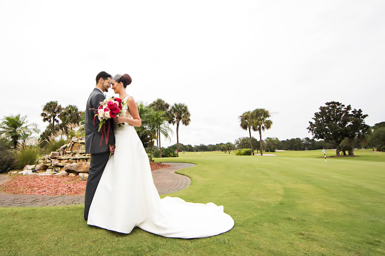 Outdoor Garden Wedding Portrait, Bride in Long Train Wedding Dress and Birdcage Veil, with White, Magenta, and Fern Bouquet | Clearwater, Florida Golf Course Wedding Venue Countryside Country Club | Wedding Dress Shop Truly Forever Bridal | Planner Special Moments Event Planning