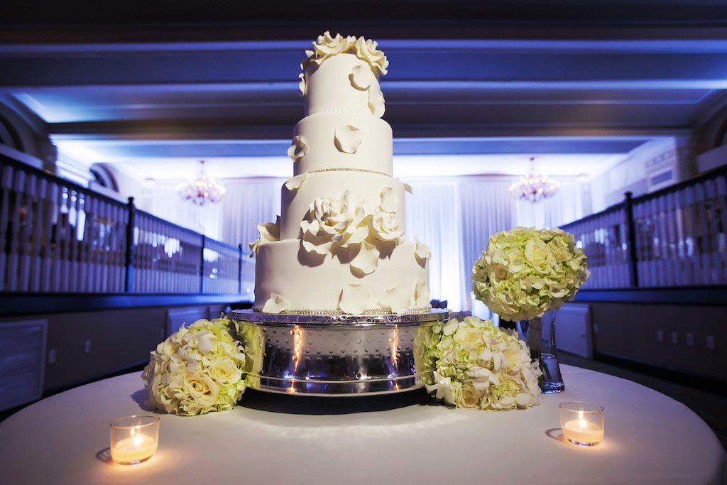Four Tier Round White Wedding Cake with White Floral Icing with Green Hydrangea Bouquets