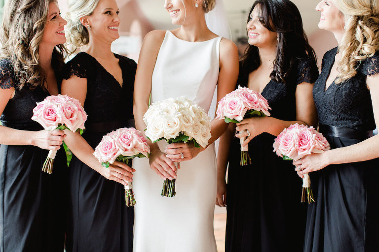 Bridal Party Portrait, Bridesmaids in Black V Neck Lace Belted David's Bridal Dresses with Pink Rose Bouquets with Greenery and Ribbon, Bride in Sleeveless Modern A Line Wedding Dress with Ivory Rose Bouquet | Tampa Bay Wedding Hair and Makeup Michele Renee The Studio | St Pete Wedding Photographer Ailyn La Torre Photography