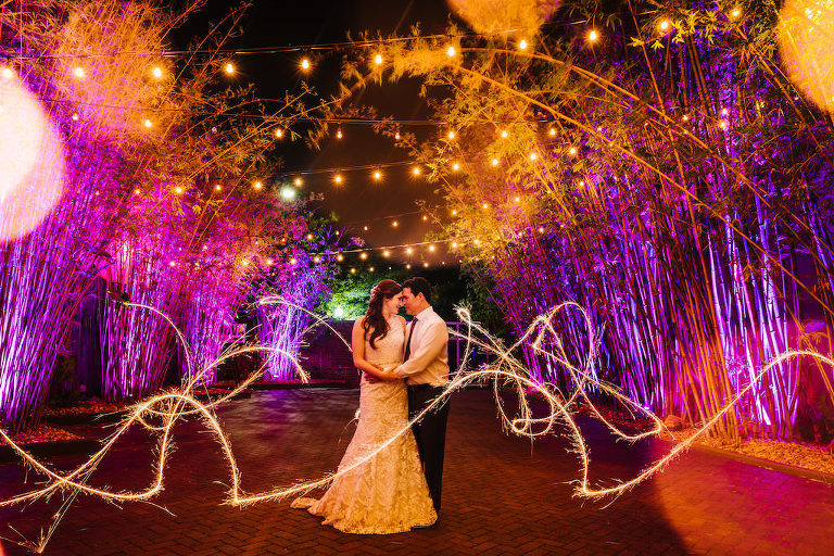 Outdoor Bamboo Garden Nighttime Bride and Groom Portrait with Sparklers at at Historic Downtown St Pete Wedding Venue NOVA 535 Bamboo Garden with String Lights