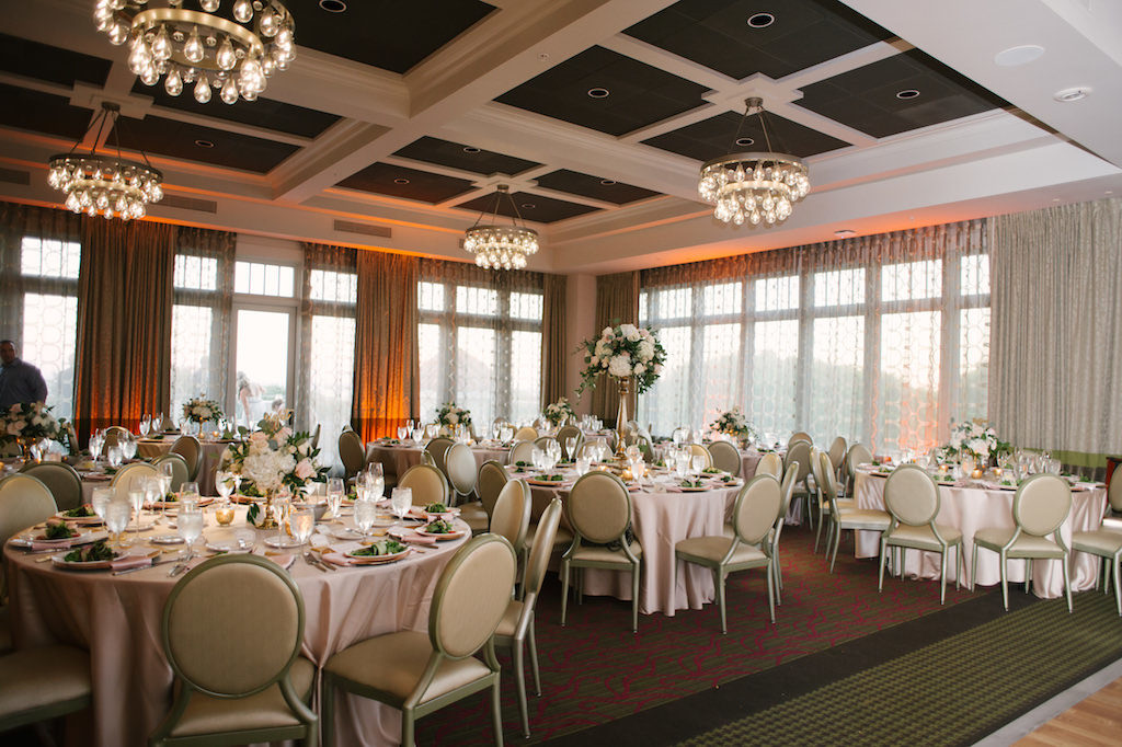 Blush and Gold Hotel Ballroom Wedding Reception with Pink Linen, and Tall White Hydrangea and Greenery Centerpieces in Tall Gold Vase | Downtown St Pete Hotel Wedding Reception Venue The Birchwood
