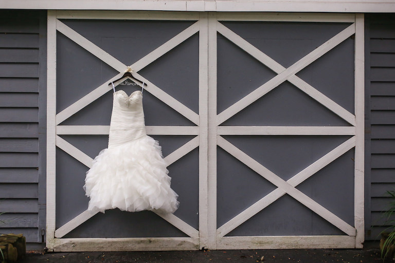 Strapless Allure Tulle Wedding Dress on Personalized Hanger on Barn Door