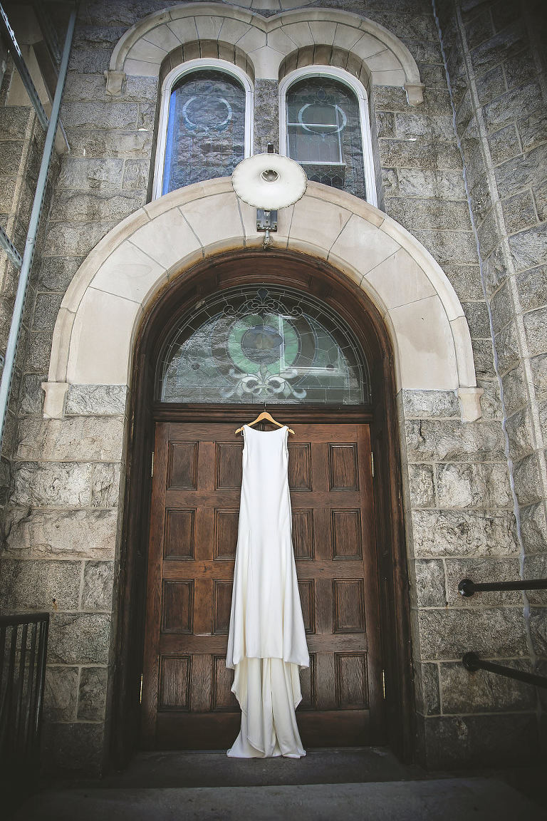 A Line Wedding Dress on Hanger on Church Door | Tampa Bay Wedding Ceremony Venue Sacred Heart Catholic Church