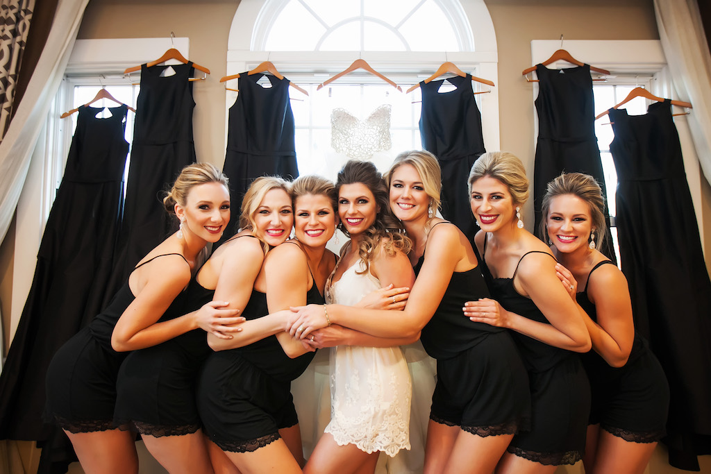 Bridal Party Getting Ready Portrait in Matching Black and White Rompers   Bella Bridesmaid Monique Lhuillier Dresses