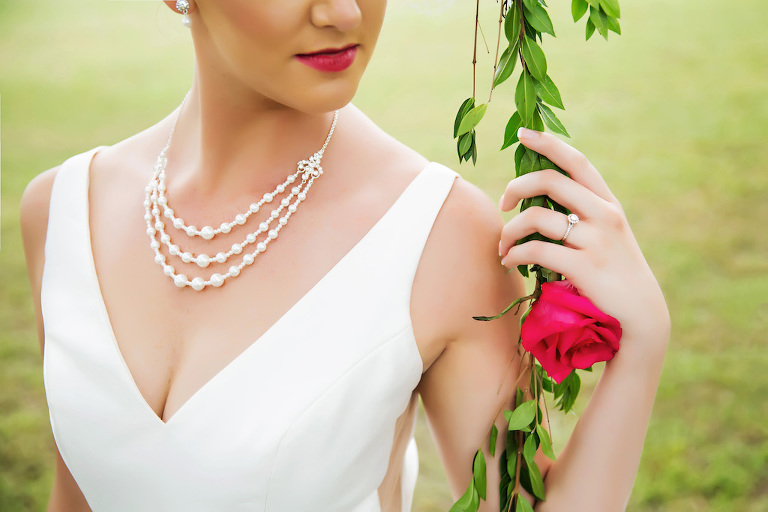 Outdoor Bridal Portrait in V-neck Wedding Dress with Three Strand Pearl Necklace | Tampa Bay Wedding Hair and Makeup Michele Renee The Studio | Bridal Shop Truly Forever Bridal